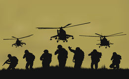 The soldiers going to attack and helicopters. Royalty Free Stock Images