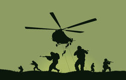 The soldiers going to attack and helicopters. Royalty Free Stock Photos