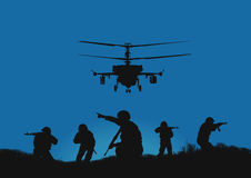 The soldiers going to attack and helicopters. Stock Images