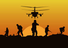 The soldiers going to attack and helicopters. Royalty Free Stock Image