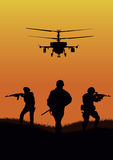 The soldiers going to attack and helicopters. Stock Photo