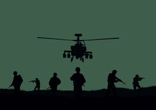 The soldiers going to attack and helicopters. Royalty Free Stock Photography