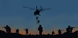 The soldiers going to attack and helicopters. Stock Photography