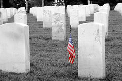Soldiers Grave - Selective Colorization. A soldier's grave with an american flag, in a military graveyard Stock Images