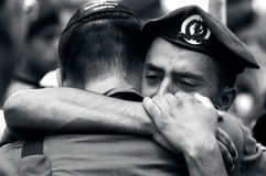 Soldiers grief. KIRYAT MALACHI, ISR - JULY 07:Israeli soldiers grief for the lost their comrade in arms on July 7 2006.Israel has suffered over 20,000 troops stock photo