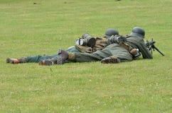 soldiers on ground with machine gun Stock Image