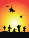 Soldiers group, military helicopters. On sunset background Royalty Free Stock Photo