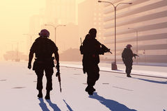 Soldiers. The group  of the soldier on the streets of a modern city Stock Photos