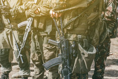 Soldiers with a gun in the hands of the patrol area. Conducting military operations Royalty Free Stock Images