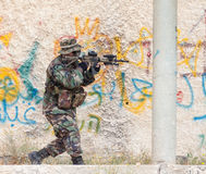 Soldiers with guns capture buildings Stock Photography