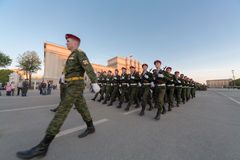 Soldiers with guns marching on parade Stock Image