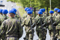 Soldiers with guns. Soldiers marching in the streets with guns on their shoulders Royalty Free Stock Photography