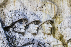 Soldiers' heads stone sculture Royalty Free Stock Photography