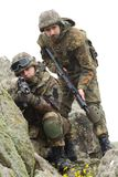 Soldiers in heavy combat ammunition Royalty Free Stock Images