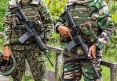 Soldiers holding their assault rifles. Two unrecognised malaysian soldiers holding their assault rifles Royalty Free Stock Image