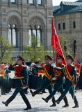 Soldiers of the honor guard special commandant of the Preobrazhensky regiment carry the flag of Victory at the rehearsal of the mi Royalty Free Stock Photo