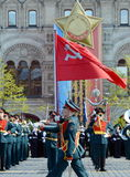 Soldiers of the honor guard special commandant of the Preobrazhensky regiment carry the flag of Victory at the rehearsal of the mi Stock Image