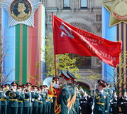 Soldiers of the honor guard special commandant of the Preobrazhensky regiment carry the flag of Victory at the rehearsal of the mi Stock Images