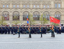 Soldiers of the honor guard special commandant of the Preobrazhensky regiment carry the Victory banner and the Russian flag at a m Stock Image