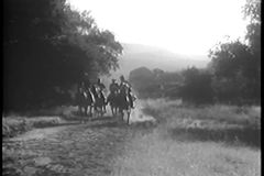 Soldiers on horseback in hot pursuit stock video footage