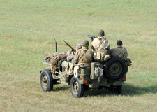 Soldiers In A Small Vehicle Stock Photo