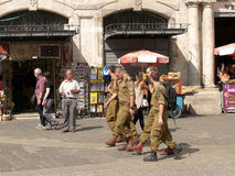 Soldiers of the Israeli army go down the street Via Doloroza in Stock Images