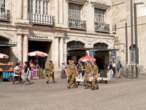 Soldiers of the Israeli army go down the street Via Doloroza in Royalty Free Stock Images