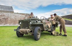 Soldiers and Jeep Royalty Free Stock Image