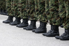 Soldiers in line. With clean black boots Royalty Free Stock Photos