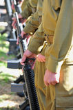 Soldiers Line Uniform Guns. Soliders in uniform line up with guns Stock Photo