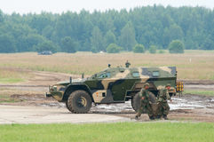 Soldiers loading cargo into KAMAZ-43269 Stock Photography