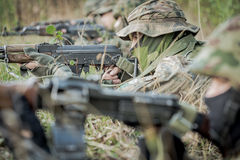 Soldiers lying on ground Stock Photo