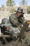 Soldiers With Machine Gun Leaning On Log Stock Image