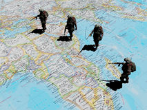 Soldiers on the map. A group of soldiers are on the world map., 3d render Royalty Free Stock Image