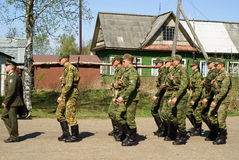Soldiers on a march. Soldiers march on settlement during celebrating of day of a victory on 9th of May Royalty Free Stock Photo