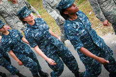 Soldiers Marching. Line of young Navy and Air Force soldiers marching wearing camouflage uniforms at a Navy Day celebration in Biloxi, MS stock photo