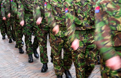 Soldiers marching. British soldiers marching in full camouflage uniform stock photography