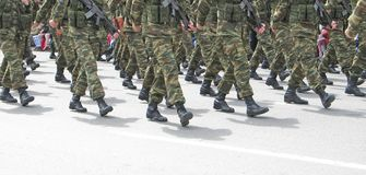 Soldiers Marching. In an army parade (faces are out of the picture, for obvious reasons stock photography