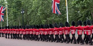 Soldiers marching down The Mall in London during the Trooping the Colour military ceremony, London. London UK. Soldiers with rifles and bayonets marching down Stock Photos