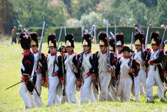 Soldiers marching with guns. Stock Images