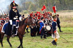 Soldiers marching with guns. Royalty Free Stock Photos