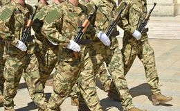 Soldiers are marching at the military parade. In summer Royalty Free Stock Image