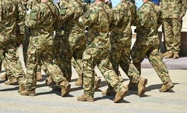 Soldiers are marching at the military parade. In summer Royalty Free Stock Images
