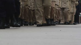 Soldiers marching on the road stock footage