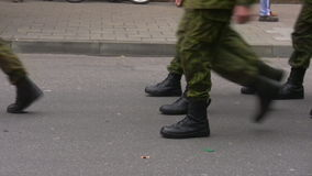 Soldiers marching. Soldier formation wearing camouflage clothes marching on a public parade stock footage