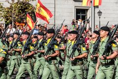 Soldiers marching in Spanish National Day Army Parade. Madrid, Spain - October 12, 2017: Soldiers marching in Spanish National Day Army Parade. Several troops Stock Photos
