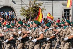 Soldiers marching in Spanish National Day Army Parade. Madrid, Spain - October 12, 2017: Soldiers marching in Spanish National Day Army Parade. Several troops Royalty Free Stock Photography