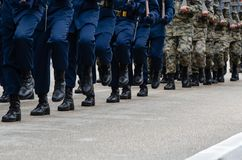 Soldiers marching on street during parade royalty free stock image