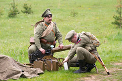 Soldiers and Maxim machine gun Stock Photos