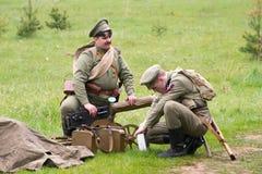 Soldiers and Maxim machine gun Stock Photos